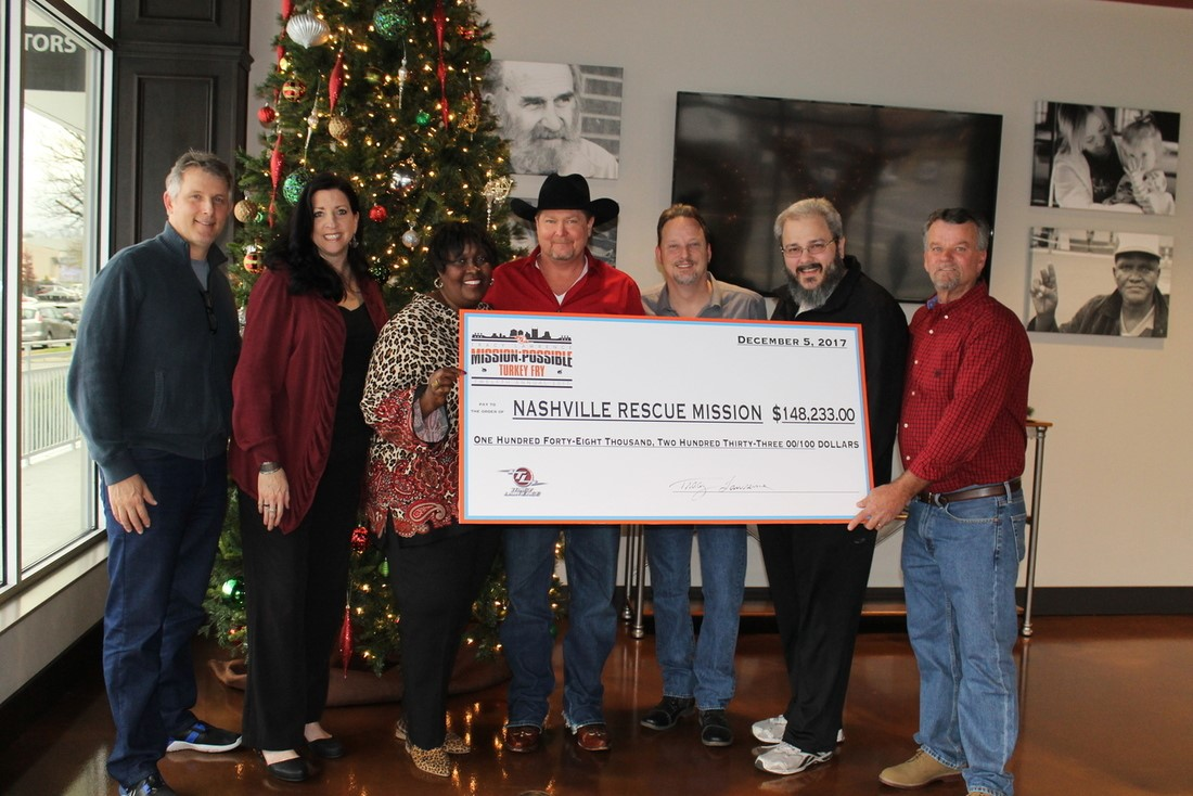 Tracy Lawrence presents $148,233.00 check to Nashville Rescue Mission