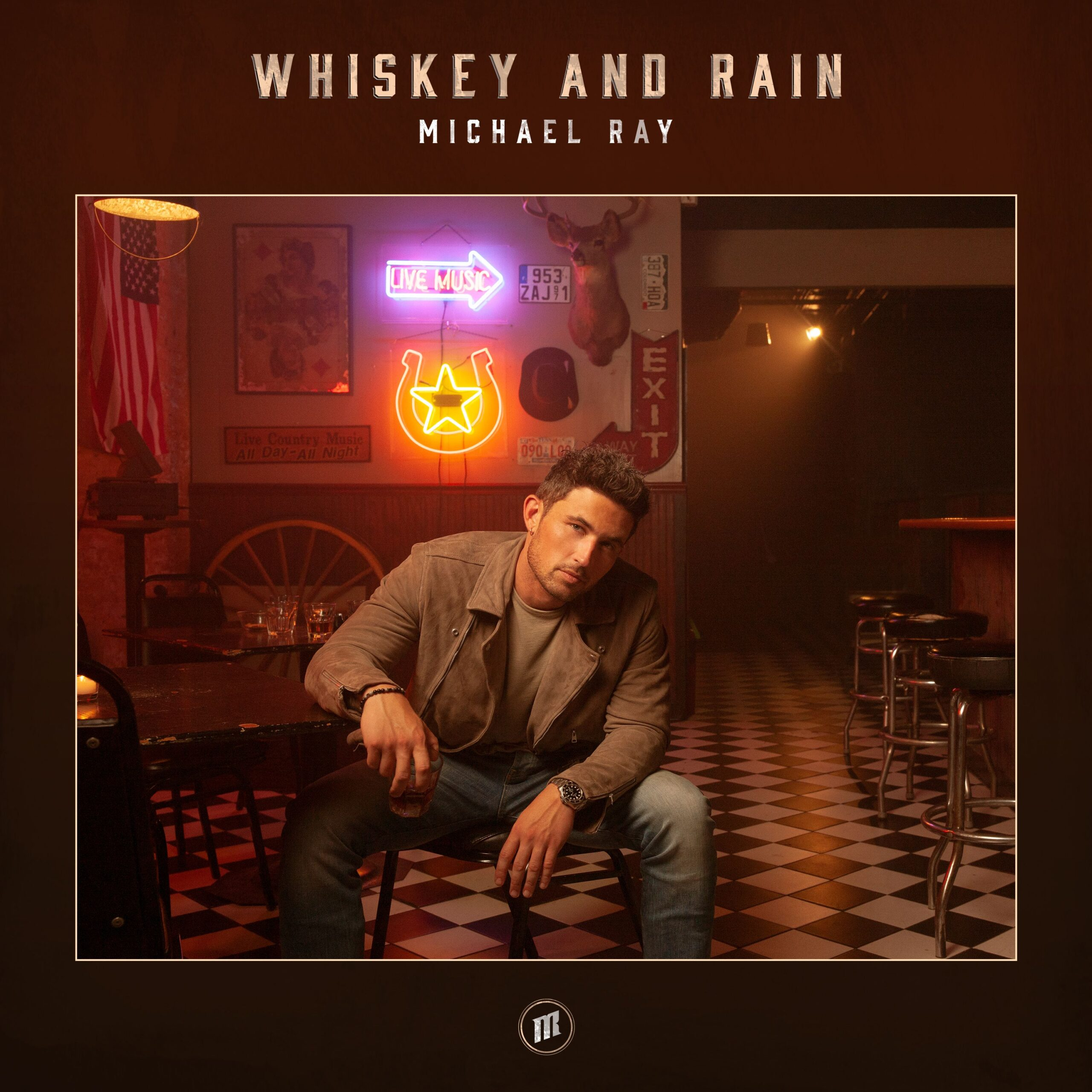 "Michael Ray delivers new single ""Whiskey And Rain"" + Performance video"
